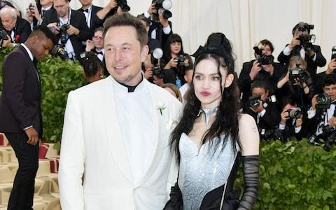 Elon Musk and Grimes, pictured at The Metropolitan Museum of Art last year - Credit: Getty
