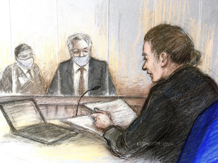 Court artist sketch by Elizabeth Cook showing Julian Assange, centre, appearing at Westminster Magistrates' Court where the WikiLeaks founder was refused bail, in London, Wednesday Jan. 6, 2021. The United States authorities are appealing against a recent court decision to block the extradition of Assange, and WikiLeaks said Wednesday the denial of bail would be appealed. (Elizabeth Cook/PA via AP)