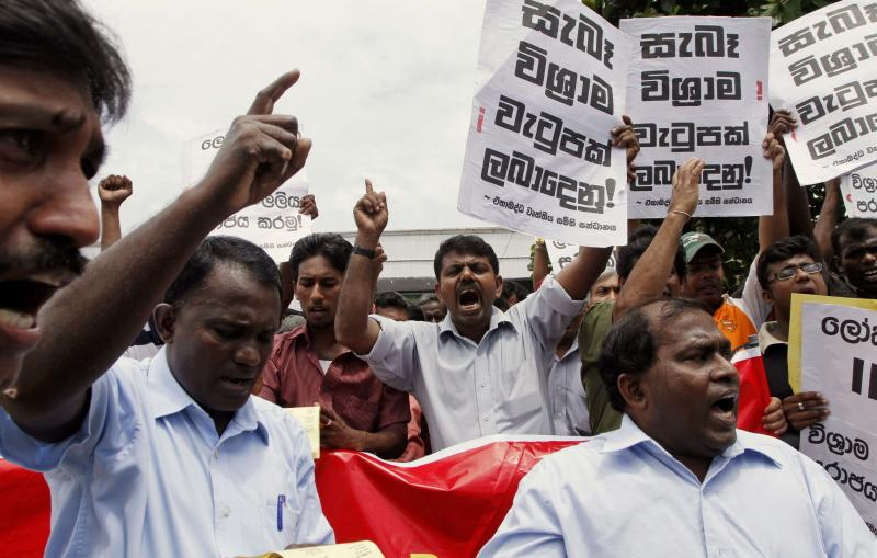 Sri Lankan private sector employees shout slogans during a protest in Colombo, Sri Lanka, Wednesday, June 1, 2011. The workers protested against the government's proposed pension scheme for private sector workers saying it is not beneficial to them and demanded government to withdraw the proposal. (AP Photo/ Eranga Jayawardena)