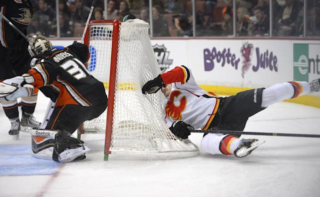 Calgary Flames left wing Lance Bouma, right, loses control and dislodges the goal as Anaheim Ducks goalie Frederik Andersen, of Denmark, defends during the first period of an NHL hockey game, Friday, Nov. 29, 2013, in Anaheim, Calif. (AP Photo/Mark J. Terrill)
