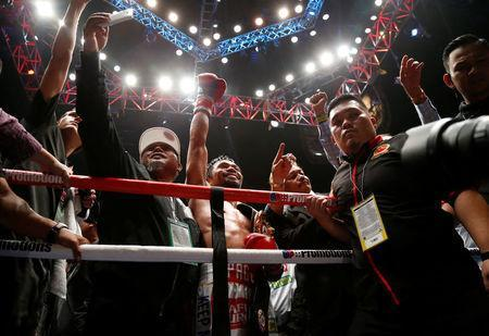 Boxing - WBA Welterweight Title Fight - Manny Pacquiao v Lucas Matthysse - Axiata Arena, Kuala Lumpur, Malaysia - July 15, 2018 Manny Pacquiao celebrates after defeating Lucas Matthysse REUTERS/Lai Seng Sin