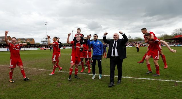 "Soccer Football - League Two - Accrington Stanley v Lincoln City - Wham Stadium, Accrington, Britain - April 28, 2018 Accrington Stanley manager John Coleman and players celebrate at the end of the match Action Images/Andrew Boyers EDITORIAL USE ONLY. No use with unauthorized audio, video, data, fixture lists, club/league logos or ""live"" services. Online in-match use limited to 75 images, no video emulation. No use in betting, games or single club/league/player publications. Please contact your account representative for further details."