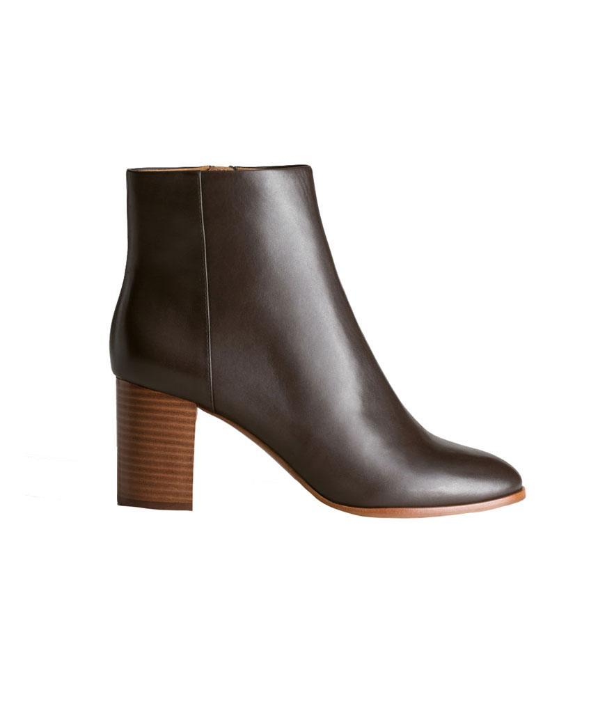 """<p>In rich dark brown, these boots have a stacked wooden heel and O-ring side zipper — a timeless style you'll wear for years to come.<br><a href=""""https://fave.co/2qwcTWo"""" rel=""""nofollow noopener"""" target=""""_blank"""" data-ylk=""""slk:Shop it:"""" class=""""link rapid-noclick-resp"""">Shop it:</a> O-Ring Zipper Leather Ankle Boots, $179, <a href=""""https://fave.co/2qwcTWo"""" rel=""""nofollow noopener"""" target=""""_blank"""" data-ylk=""""slk:stories.com"""" class=""""link rapid-noclick-resp"""">stories.com</a> </p>"""