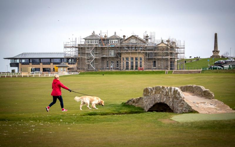 In Scotland, people have been able to walk their dogs on golf courses - but not to tee off - Jane Barlow/PA