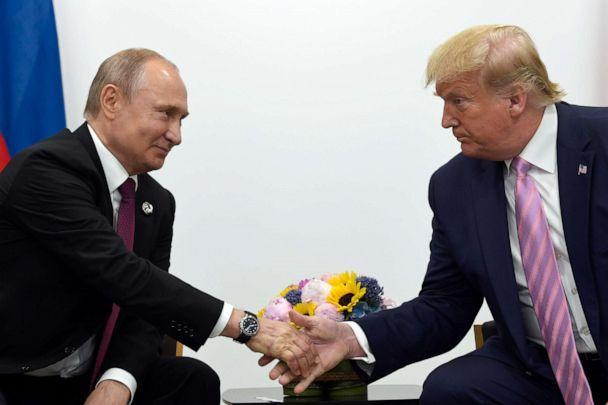 PHOTO: In this June 28, 2019, file photo, President Donald Trump, right, shakes hands with Russian President Vladimir Putin, left, during a bilateral meeting on the sidelines of the G-20 summit in Osaka, Japan. (Susan Walsh/AP, FILE)