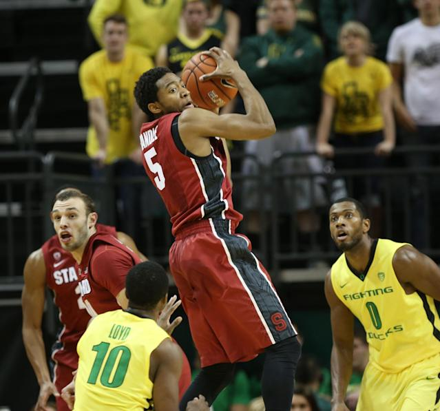 Stanford's Chasson Randle, center, comes down with an Oregon pass with teammate Robbie Lemons, left, defended by Oregon's Johnathan Loyd and Mike Moser, right, during the first half of an NCAA basketball game in Eugene, Ore., Sunday, Jan. 12, 2014. (AP Photo/Chris Pietsch)