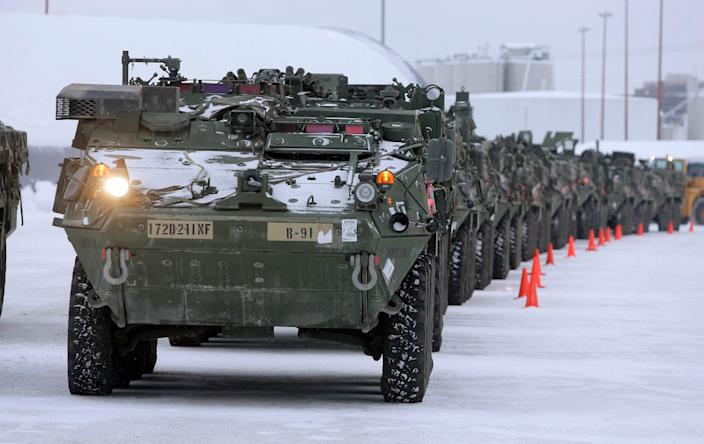 Stryker vehicles sit in a storage yard at the Port of Anchorage in Alaska, awaiting transport to Fort Wainwright, after a deployment.