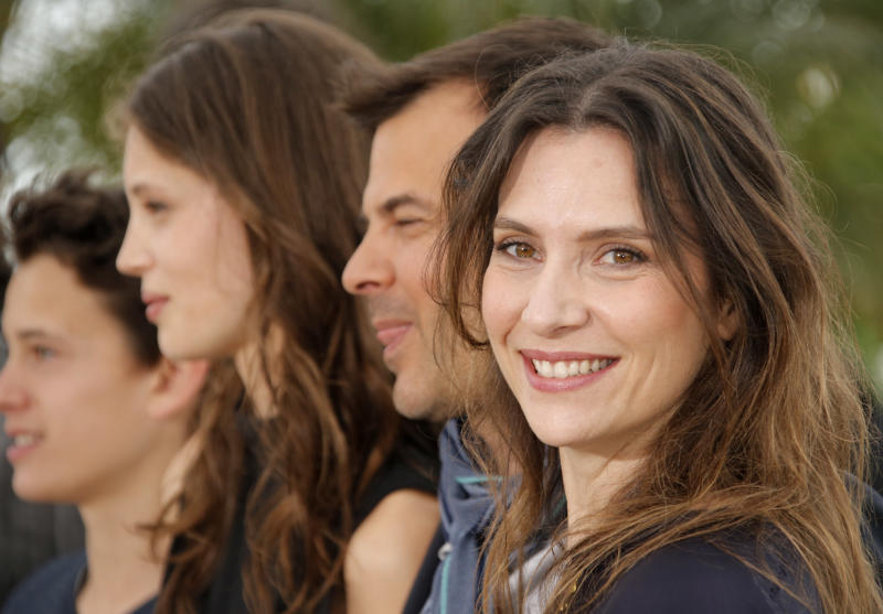 Director Francois Ozon, second right, poses with actors, from right, Geraldine Pailhas, Marine Vacth and Fantin Ravat during a photo call for the film Young & Beautiful at the 66th international film festival, in Cannes, southern France, Thursday, May 16, 2013. (AP Photo/Francois Mori)