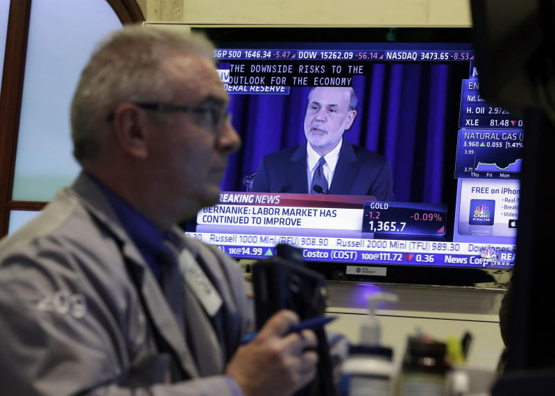 Stocks slide as Fed says bond purchases could slow