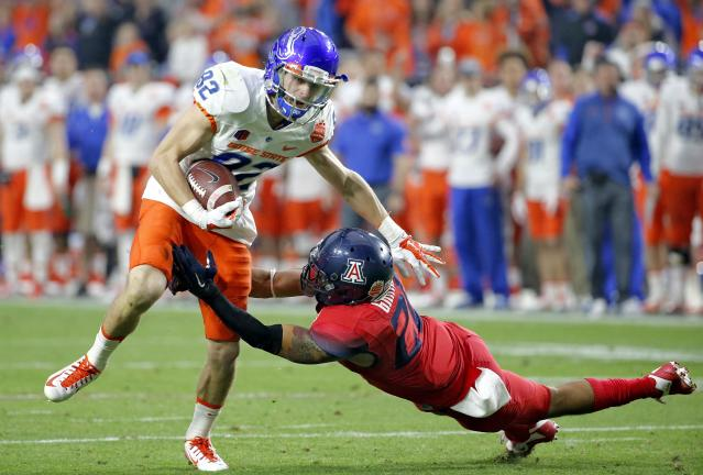 Boise State wide receiver Thomas Sperbeck (82) is hit by Arizona cornerback Jarvis McCall Jr. during the first half of the Fiesta Bowl NCAA college football game, Wednesday, Dec. 31, 2014, in Glendale, Ariz. (AP Photo/Ross D. Franklin)