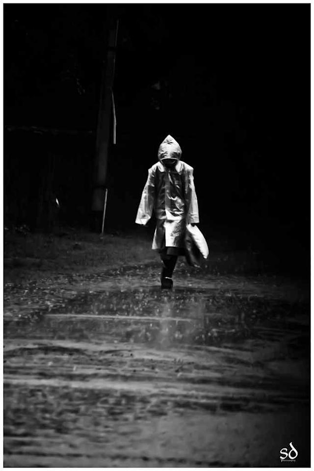 "Child in raincoat <br>By <a target=""_blank"" href=""http://www.flickr.com/photos/swrz/"">Swarup Dayal</a>"
