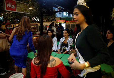 A group of Indonesian transvestites spend their time at a cafe in Jakarta, Indonesia, February 8, 2018.  Picture taken February 8, 2018. REUTERS/Beawiharta