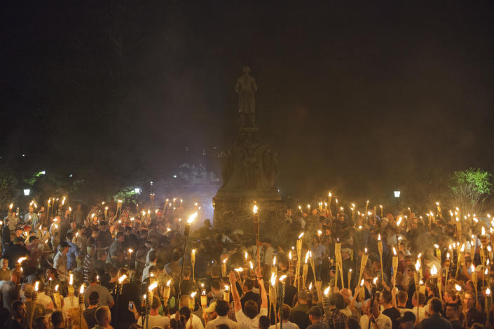 Neo Nazis, Alt-Right, and White Supremacists encircle counter protestors at the base of a statue of Thomas Jefferson after marching through the University of Virginia campus with torches in Charlottesville, Va., USA on August 11, 2017 (Photo: Shay Horse/NurPhoto via Getty Images)