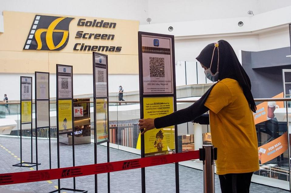 GSC Cinema staff prepare for reopening at the Mid Valley Megamall outlet in Kuala Lumpur September 8, 2021. — Picture by Shafwan Zaidon
