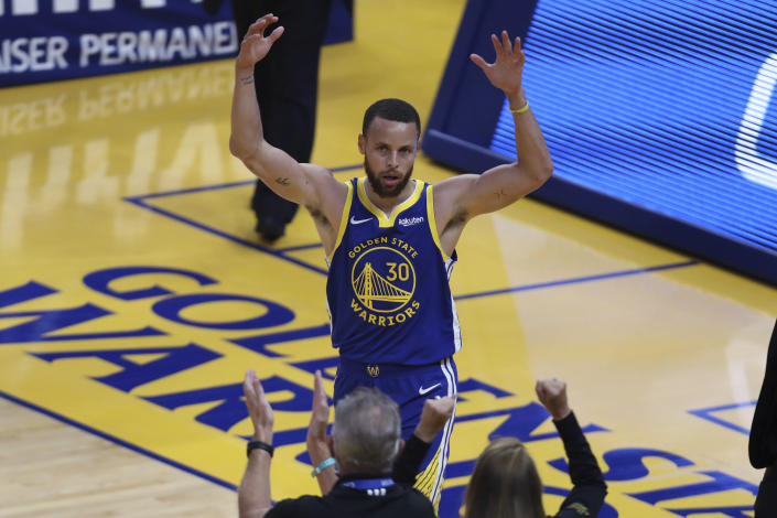 Golden State Warriors' Stephen Curry waves to the crowd after scoring against the Oklahoma City Thunder during the first half of an NBA basketball game in San Francisco, Saturday, May 8, 2021. (AP Photo/Jed Jacobsohn)