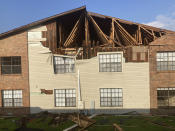 An apartment building in Houma, La., that was damaged by Hurricane Ida is seen, Sunday, Sept. 5, 2021. The storm caused such extensive damage to the buildings in the complex that residents have to move out. (AP Photo/Rebecca Santana)