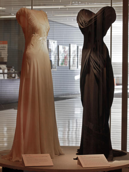 """A design by Irene, left, from the 1948 MGM movie """"State of the Union,"""" and one by Walter Plunkett from the 1949 MGM movie """"Adam's Rib,"""" are shown as part of the """"Katharine Hepburn: Dressed for Stage and Screen"""" exhibit in the New York Public Library for the Performing Arts at Lincoln Center, Tuesday, Oct. 16, 2012. (AP Photo/Richard Drew)"""