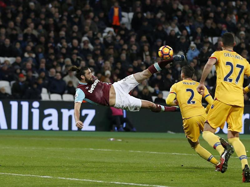 Carroll's scissor kick beat Giroud's volley to the gong (Getty)