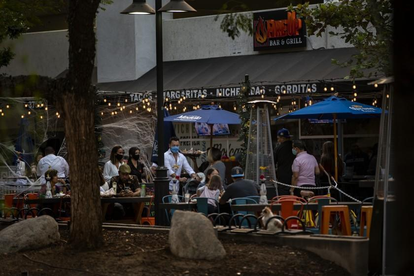 RIVERSIDE, CA - OCTOBER 21, 2020: The outdoor seating area at Fire Up Bar & Grill is crowded as rising coronavirus rates forced Riverside County back into the most restrictive tier of the state's coronavirus reopening framework on October 21, 2020 at the Riverside Plaza in Riverside, California. The new health ruling means that restaurants, gyms, movies theaters and places of worship can no longer have limited indoor operations.(Gina Ferazzi / Los Angeles Times)