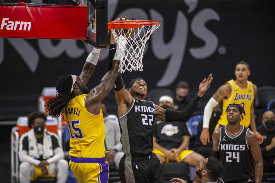 Los Angeles Lakers center Montrezl Harrell (15) goes to the basket as he's defended by Sacramento Kings center Richaun Holmes (22) during eth second quarter of an NBA basketball game in Sacramento, Calif., Wednesday, March 3, 2021. (AP Photo/Hector Amezcua)
