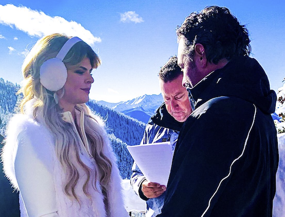 "<div class=""caption""> Allenby officiates the wedding of Troyanovich and Stout on top of a mountain in Aspen, Colo. </div>"