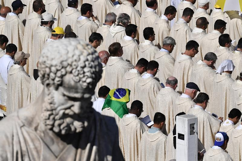 Before a crowd of some 35,000 in St Peter's square, Pope Francis carries out the rite of canonisation for 30 martyrs massacred in Brazil in the 17th century