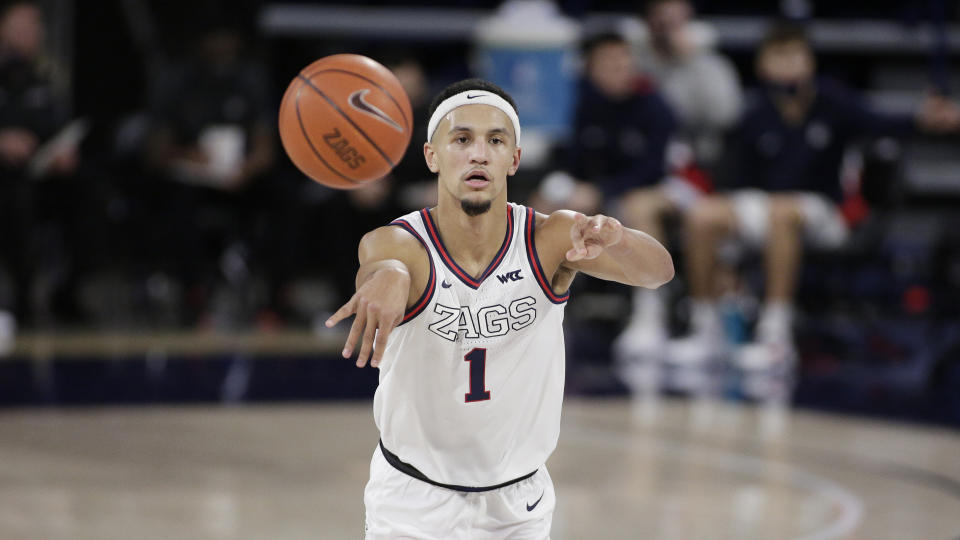 Gonzaga guard Jalen Suggs passes the ball during the first half of an NCAA college basketball game against Saint Mary's in Spokane, Wash., Thursday, Feb. 18, 2021. (AP Photo/Young Kwak)