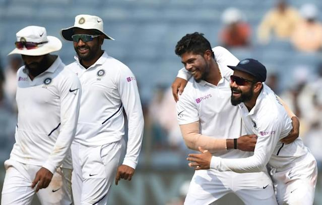 Indian players celebrate the wicket of South African Vernon Philander en route to victory in the second Test in Pune (AFP Photo/PUNIT PARANJPE)