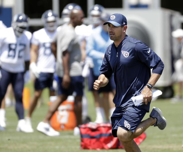Tennessee Titans offensive coordinator Matt LaFleur demonstrates a pass route during an organized team activity at the NFL football team's training facility Tuesday, June 5, 2018, in Nashville, Tenn. LaFleur wants to make sure Marcus Mariota is as comfortable with Tennessee's new offense as possible, planning to call plays that fit his quarterback best. (AP Photo/Mark Humphrey)