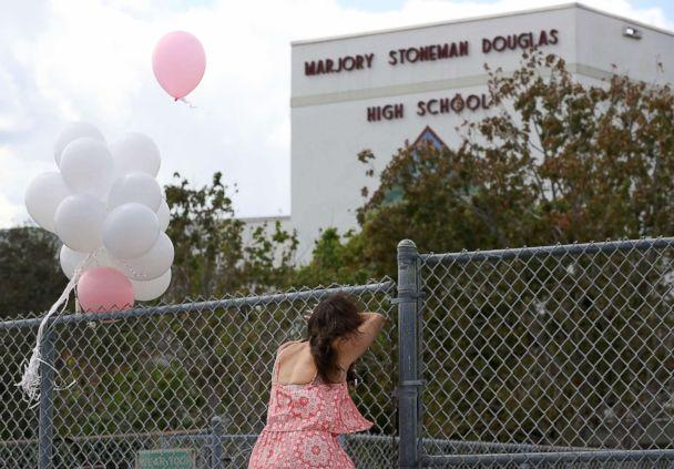 PHOTO: Angela Tanner, rests against the fence that surrounds the Marjory Stoneman Douglas High School, Feb. 18, 2018 in Parkland, Fla. (Mark Wilson/Getty Images)