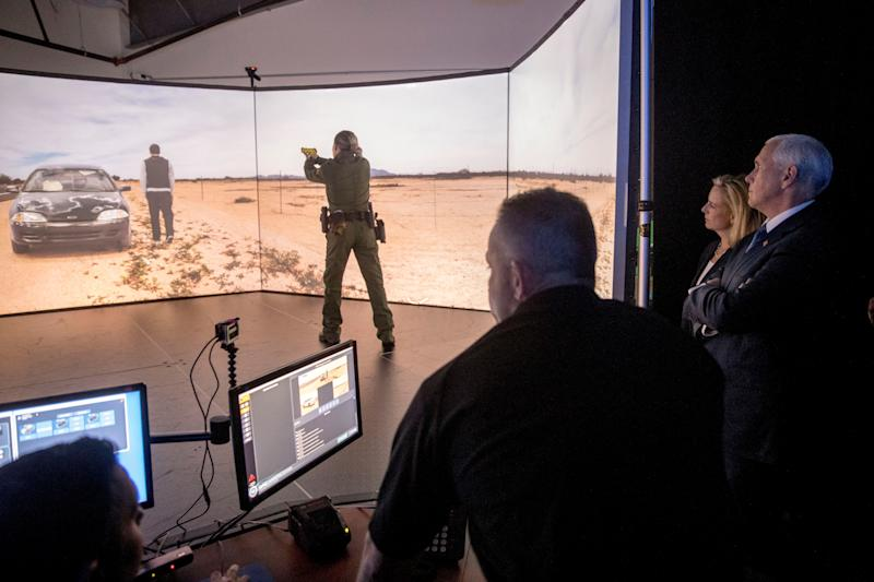 Vice President Mike Pence (right) and Homeland Security Secretary Kirstjen Nielsen (second from right) watches Virtual Simulator Training during a visit to the U.S. Customs and Border Protection's Advanced Training Facility in Harpers Ferry, W.Va., on March 13, 2019.