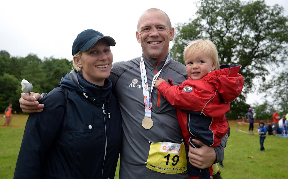 ABERFELDY, SCOTLAND - JULY 11:  Zara Phillips and daughter Mia Tindall pose for a photograph after husband Ex England rugby star Mike Tindall finished the grueling Artemis Great Kindrochit Quadrathlon in Loch Tay Scotland on July 11, 2015 in Aberfeldy, Scotland.  (Photo by Nigel Roddis/Getty Images for Artemis Quadrathlon)