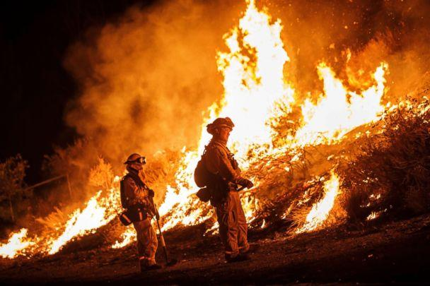 PHOTO: Firefighters conduct a burn operation to remove fuel around homes on Grand Ave as the Holy Fire grows to more than 10,000 acres as the wildfire comes closer to Lake Elsinore, Aug. 10, 2018. (Marcus Yam/Los Angeles Times/Polaris)
