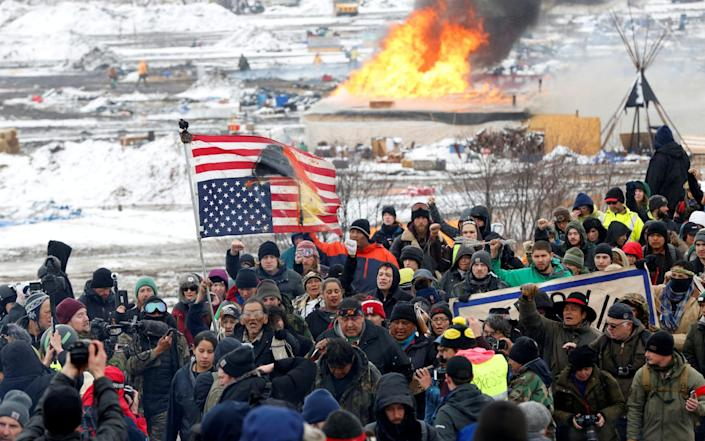 Opponents of the Dakota Access oil pipeline march out of their main camp near Cannon Ball - Terray Sylvester /Reuters