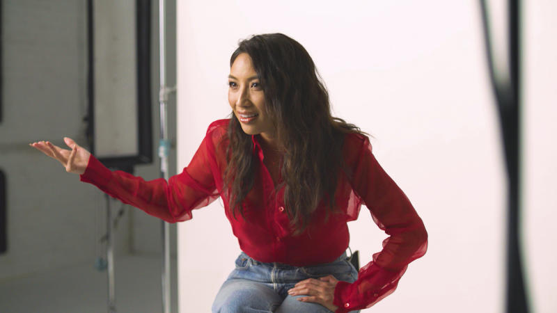"""In this Nov. 22, 2019, photo provided by Ajinomoto, Jeannie Mai, co-host of TV's """"The Real,"""" is seen in New York filming a video for a campaign challenging Merriam-Webster's dictionary entry of """"Chinese restaurant syndrome.""""  Eddie Huang, a New York City-based chef and author (his memoir inspired the ABC sitcom """"Fresh Off the Boat""""), and TV's """"The Real"""" co-host  Mai are launching a social media effort Tuesday with Ajinomoto, the longtime Japanese producer of MSG seasonings. They plan to use the hashtag #RedefineCRS to challenge Merriam-Webster to rewrite the definition.  (Courtesy of Ajinomoto via AP)"""