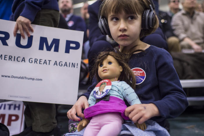 <p>Anne-Sophie Marquis, 5, holds her doll wearing a Donald Trump button as she waits for the Republican presidential candidate to speak at a campaign rally at Plymouth State University in Holderness, N.H., on Feb. 7, 2016. <i>(Photo: Jabin Botsford/The Washington Post via Getty Images)</i></p>