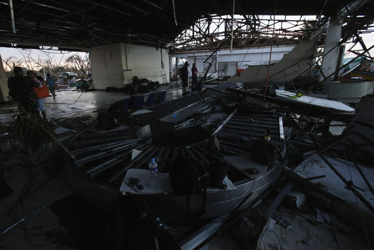 A view inside a damaged airport after super Typhoon Haiyan battered Tacloban city in central Philippines November 9, 2013. Possibly the strongest typhoon ever to hit land devastated the central Philippine city of Tacloban, killing at least 100 people, turning houses into rubble and leveling the airport in a surge of flood water and high wind, officials said on Saturday. The toll of death and damage from Typhoon Haiyan on Friday is expected to rise sharply as rescue workers and soldiers reach areas cut off by the massive, fast-moving storm which weakened to a category 4 on Saturday. REUTERS/Erik De Castro (PHILIPPINES - Tags: DISASTER ENVIRONMENT TRANSPORT)