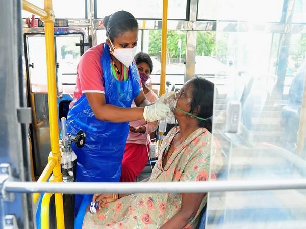 A COVID patient gets oxygen facility in a BMTC bus in Bengaluru. (Photo/ANI)