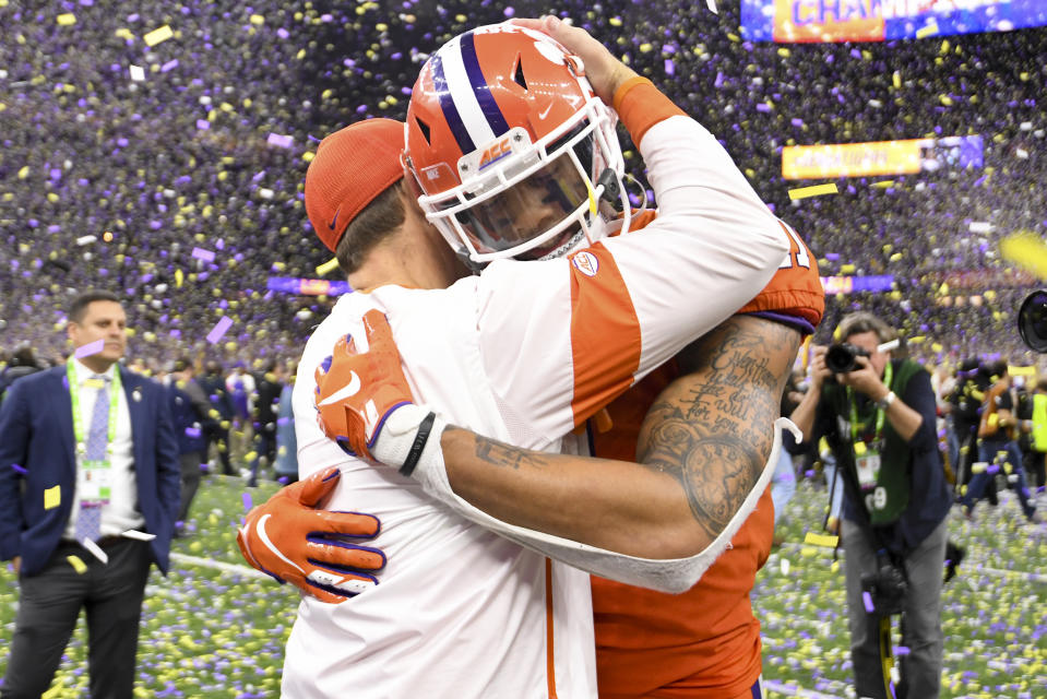 Clemson head coach Dabo Swinney embraces Isaiah Simmons after the College Football Playoff national championship at the Mercedes-Benz Superdome on Jan. 13, 2020 in New Orleans, Louisiana. (Photo by Justin Tafoya/Getty Images)