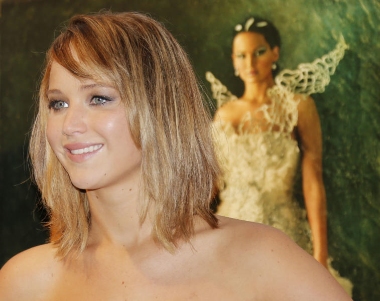 Actress Jennifer Lawrence poses for photographers during a photo call for the film The Hunger Game: Catching Fire at the 66th international film festival, in Cannes, southern France, Saturday, May 18, 2013. (Photo by Todd Williamson/Invision/AP)