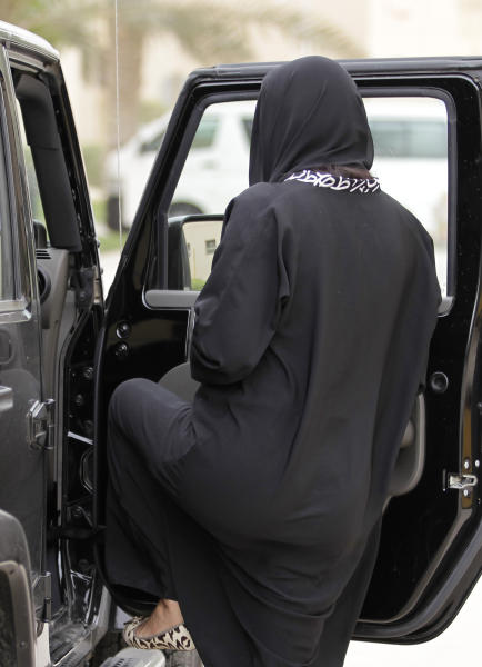 FILE - In this file photo taken Tuesday, May 24, 2011, a woman gets into a car in Riyadh, Saudi Arabia. A campaign calling on women to drive on Saturday, Oct. 26, 2013, has started gathering support online and already has nearly 15,000 signatures. (AP Photo/Hassan Ammar, File)