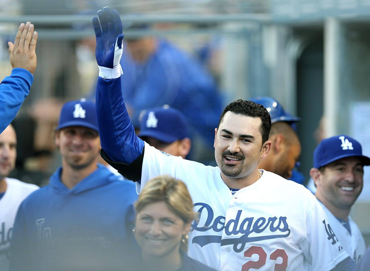 LOS ANGELES, CA - AUGUST 25:  First baseman Adrian Gonzalez #23 of the Los Angeles Dodgers celebrates in the dugout after hitting a three run home run in his first at bat as a Dodger in the first inning against the Miami Marlins on August 25, 2012 at Dodger Stadium in Los Angeles, California.  (Photo by Stephen Dunn/Getty Images)