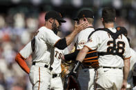 San Francisco Giants manager Gabe Kapler, left, removes Logan Webb, center, in the eighth inning of a baseball game against the San Diego Padres in San Francisco, Sunday, Oct. 3, 2021. (AP Photo/John Hefti)