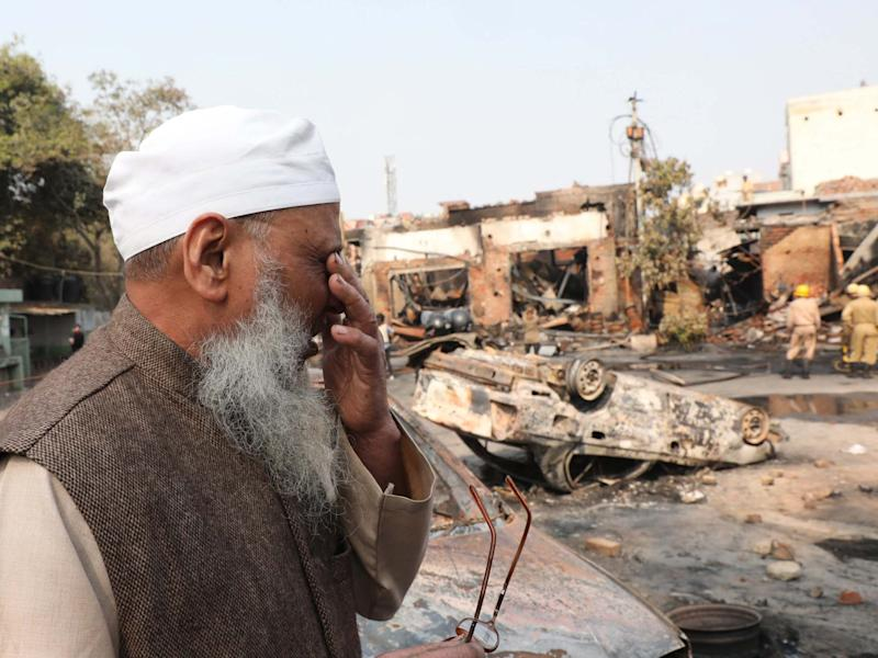 Indian Muslim man reacts as he looks at a burnt market clashes in New Delhi: EPA