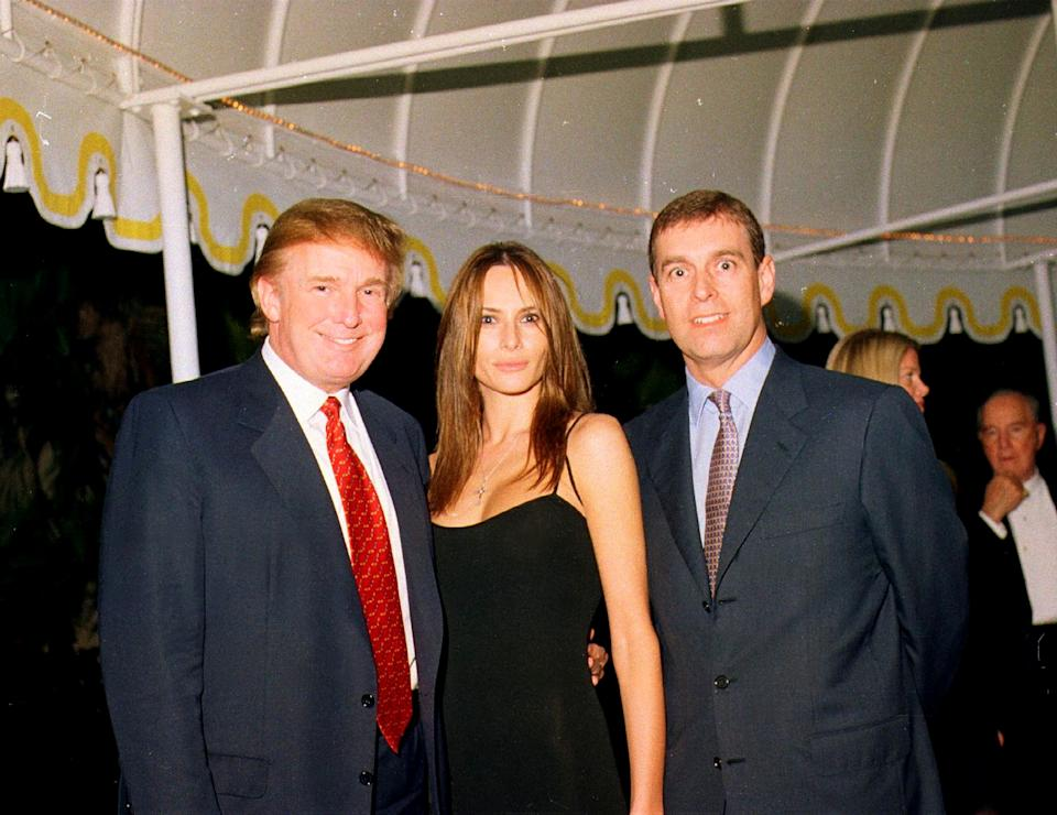 Portrait of, from left, American real estate developer Donald Trump, his girlfriend (and future wife), former model Melania Knauss, and British Prince Andrew, Duke of York, as they pose together at the Mar-a-Lago estate, Palm Beach, Florida, February 12, 2000. (Photo by Davidoff Studios/Getty Images)