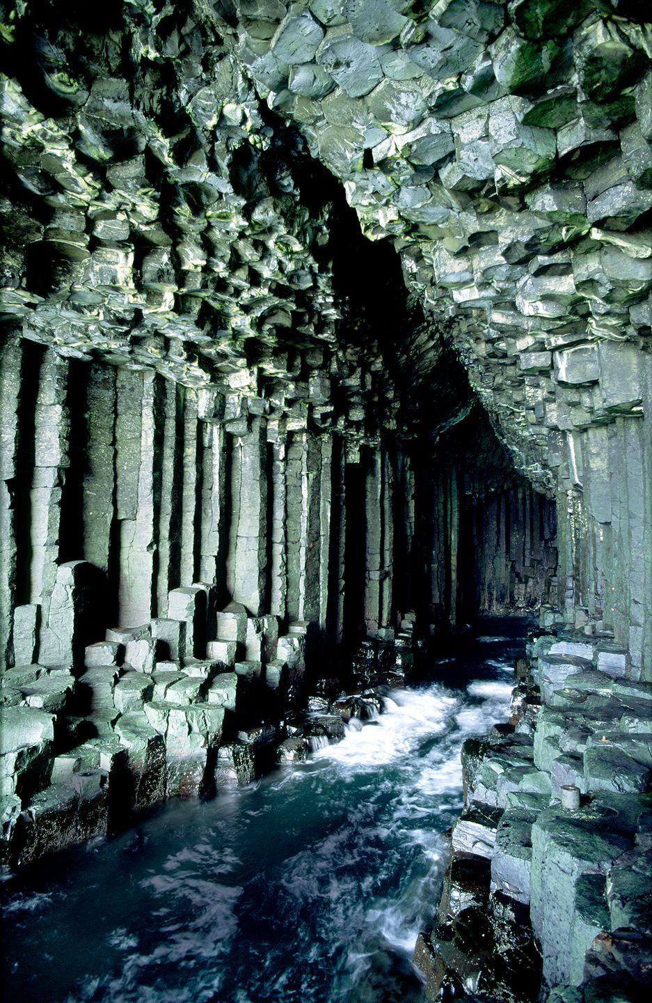 """<p>Beyond the entrance of Fingal's Cave, hexagonal columns of basalt jut out of the swirling surf. Located on the wild Isle of Staffa in the Hebrides, this otherworldly cavern was formed millions of years ago when a volcanic eruption sent lava spilling out into the sea. Known to the Celts as Uamh-Binn, or 'Cave of Melody', the grotto is famed for its natural acoustics – crashing waves reverberating around the walls like a coastal cathedral. A source of inspiration for everyone from composer Felix Mendelssohn to the members of Pink Floyd, this natural wonder also appeared in Jules Verne's Journey to the Centre of the World.</p><p><a class=""""link rapid-noclick-resp"""" href=""""https://www.visitscotland.com/see-do/unique-experiences-map/seeing-a-unique-cave/"""" rel=""""nofollow noopener"""" target=""""_blank"""" data-ylk=""""slk:MORE INFO"""">MORE INFO</a></p>"""