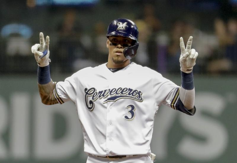 "Milwaukee Brewers' Orlando Arcia signals ""22"" for teammate Christian Yelich after Arcia hit an RBI double during the sixth inning of a baseball game against the San Diego Padres Monday, Sept. 16, 2019, in Milwaukee. (AP Photo/Morry Gash)"