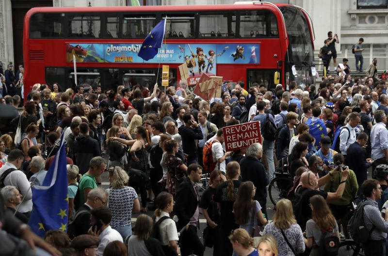 Anti-Brexit supporters gather outside the Prime Minister's residence 10 Downing Street in London, Wednesday, Aug. 28, 2019. British Prime Minister Boris Johnson asked Queen Elizabeth II on Wednesday to suspend Parliament, throwing down the gauntlet to his critics and causing outrage among opposition leaders who will have even less time to thwart a no-deal Brexit. (AP Photo/Matt Dunham)