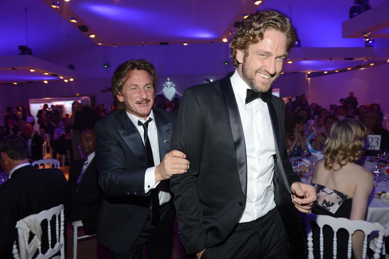 CANNES, FRANCE - MAY 18:  Actor Sean Penn (L) and actor Gerard Butler attend the Haiti Carnival in Cannes Benefitting J/P HRO, Artists for Peace and Justice & Happy Hearts Fund Presented By Armani during the 65th Annual Cannes Film Festival on May 18, 2012 in Cannes, France.  (Photo by Michael Buckner/Getty Images)