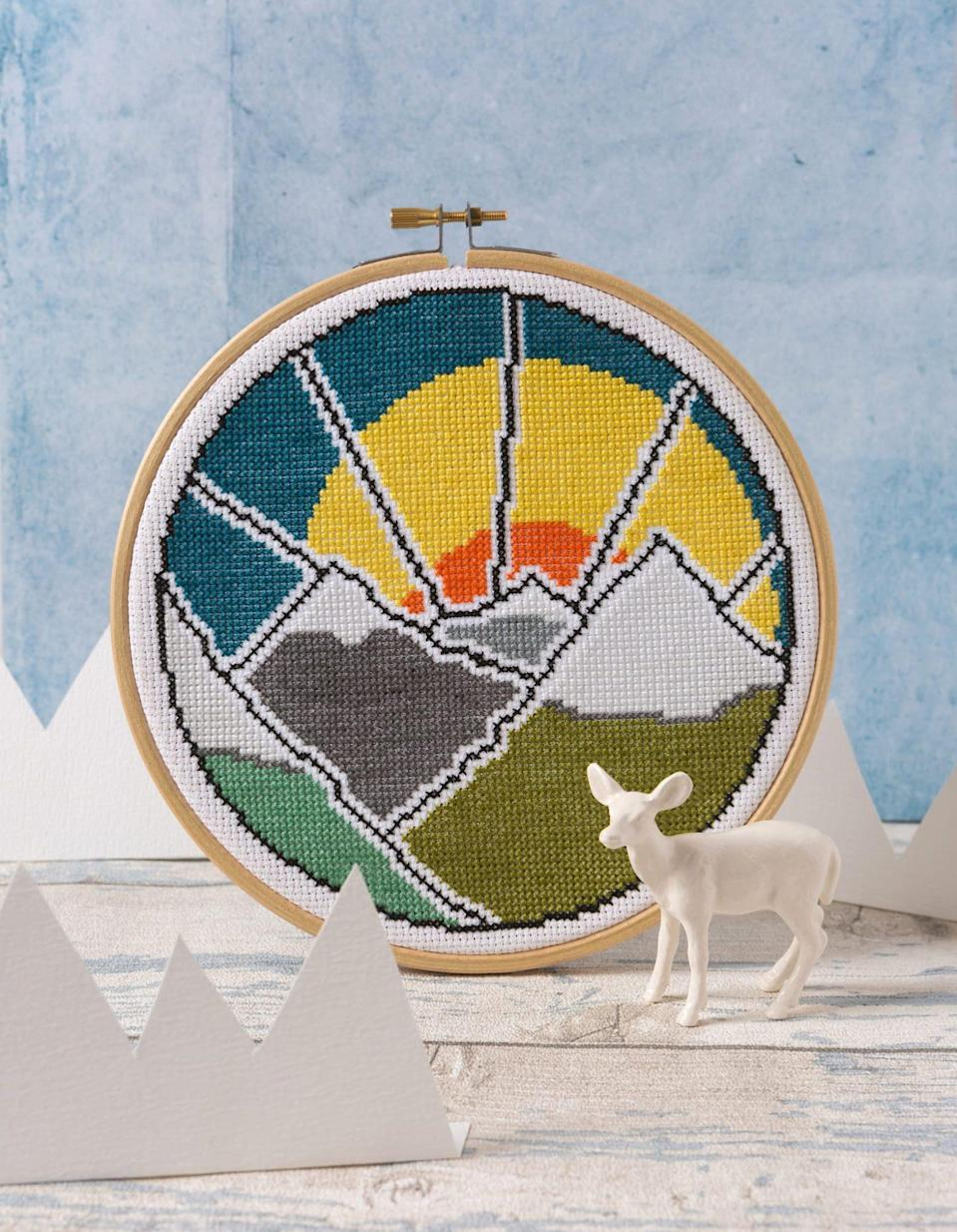 """<p>The bright landscape by Stephanie Carswell is achievable with just one stitch (no back stitching or quarter stitches required) and the color blocks and simple lines make the pattern easy to follow.</p> <p><strong><em>Shop Now:</em></strong><em> Hawthorn Handmade Mountain Adventure Cross Stitch Kit, $27, </em><a href=""""https://fancytigercrafts.com/collections/kits/products/mountain-adventure-cross-stitch-kit"""" rel=""""nofollow noopener"""" target=""""_blank"""" data-ylk=""""slk:fancytigercrafts.com"""" class=""""link rapid-noclick-resp""""><em>fancytigercrafts.com</em></a><em>.</em></p>"""
